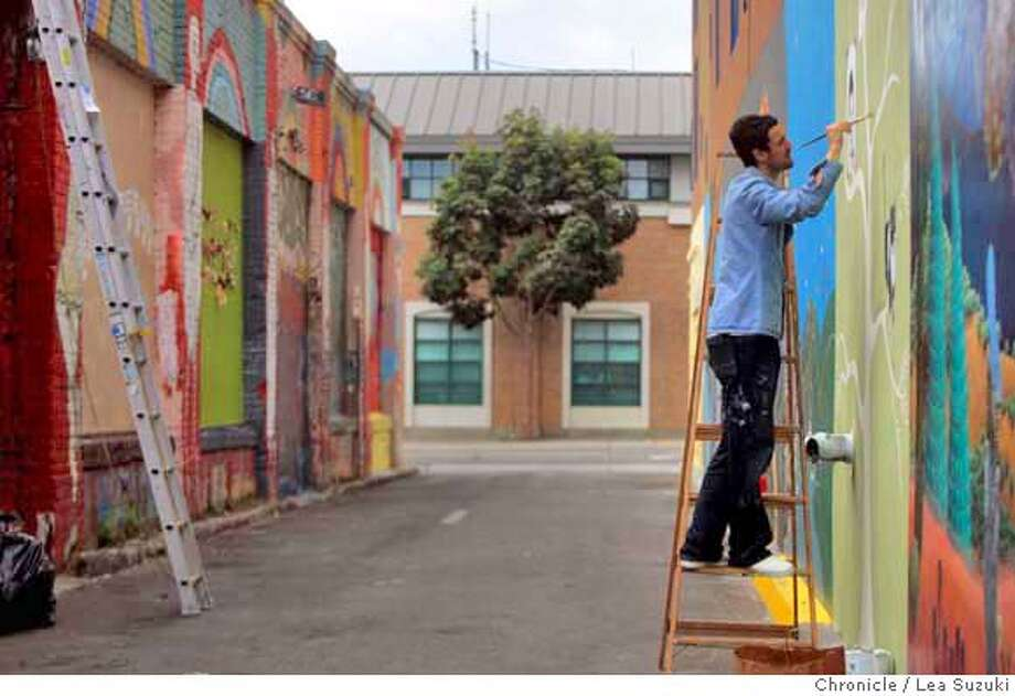 """Bryan Dawson works on a mural on Clarion Alley. Bryan Dawson played a large part in the new indie film, """"Quality of Life,"""" when it was filmed in the Mission last year - although you never saw his face. He was a """"stunt double,"""" doing the painting for actors pretending to be graffiti artists. Dawson, who has done jail time for his obsession, has gone legit, working as an animator and artist. He's even on the board of Clarion Alley muralists in the Mission, a sanctioned block of wall-paintings, some by famous artists. he's just beginning to paint a new section of Clarion, and will be working on it Monday. We shoot him in process. Photo taken on 11/3/04 in San Francisco, CA.  Lea Suzuki/ San Francisco Chronicle MANDATORY CREDIT FOR PHOTOG AND SF CHRONICLE/ -MAGS OUT Datebook#Datebook#Chronicle#11/9/2004#ALL#Advance##0422450117 Photo: Lea Suzuki"""