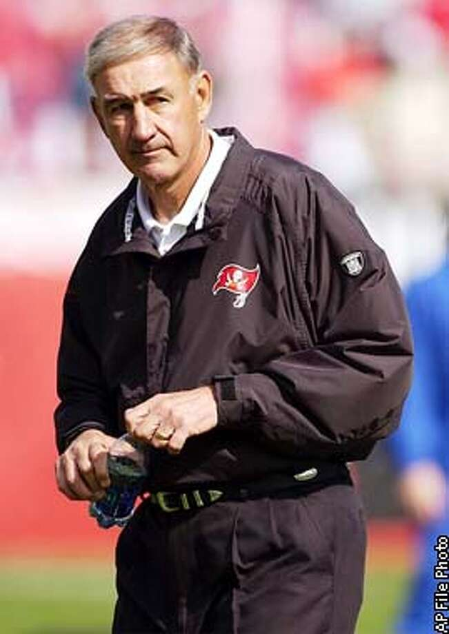 ** FILE** Tampa Bay Buccaneers defensive coordinator Monte Kiffin watches the team warm up during their NFC divisional playoff game against the San Francisco 49ers in Tampa, Fla., Sunday, Jan. 12, 2003. Kiffin agreed Wednesday, Jan. 29, 2003, to interview for the San Francisco 49ers' vacant head coaching position. Kiffin will fly to California for an interview Friday or Saturday, a team spokesman said.(AP Photo/J. Pat Carter) Photo: J. PAT CARTER