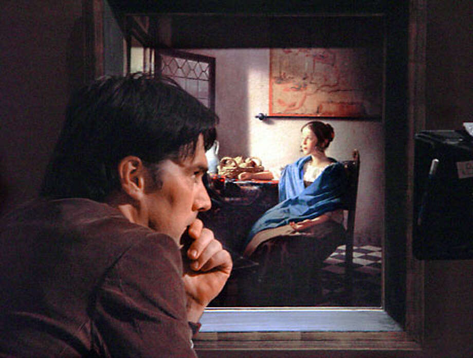 "Thomas Gibson, playing an art teacher, contemplates a rare Vermeer painting in the Hallmark Hall of Fame movie ""Brush With Fate."""