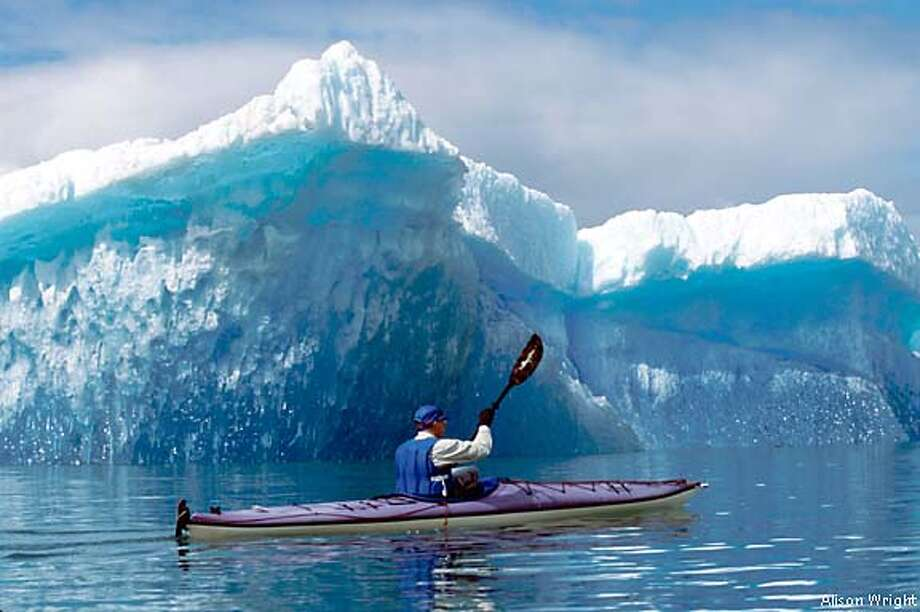 A sole kayaker glides past melting ice that probably formed 800 years ago. Photo by Alison Wright, special to the Chronicle