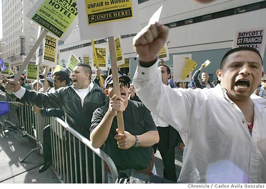 HOTEL_006_CAG.JPG  Hotel workers chant in front of the San Francisco Hilton during a protest for their contract. Union hotel workers from Local 2, marched around Union Square and to several hotels in the area to bring attention to not having a contract with several hotel chains on Tuesday, May 3, 2005.  Photo by Carlos Avila Gonzalez/The San Francisco Chronicle  Photo taken on 5/3/05, in San Francisco, Ca. MANDATORY CREDIT FOR PHOTOG AND SF CHRONICLE/ -MAGS OUT Photo: Carlos Avila Gonzalez