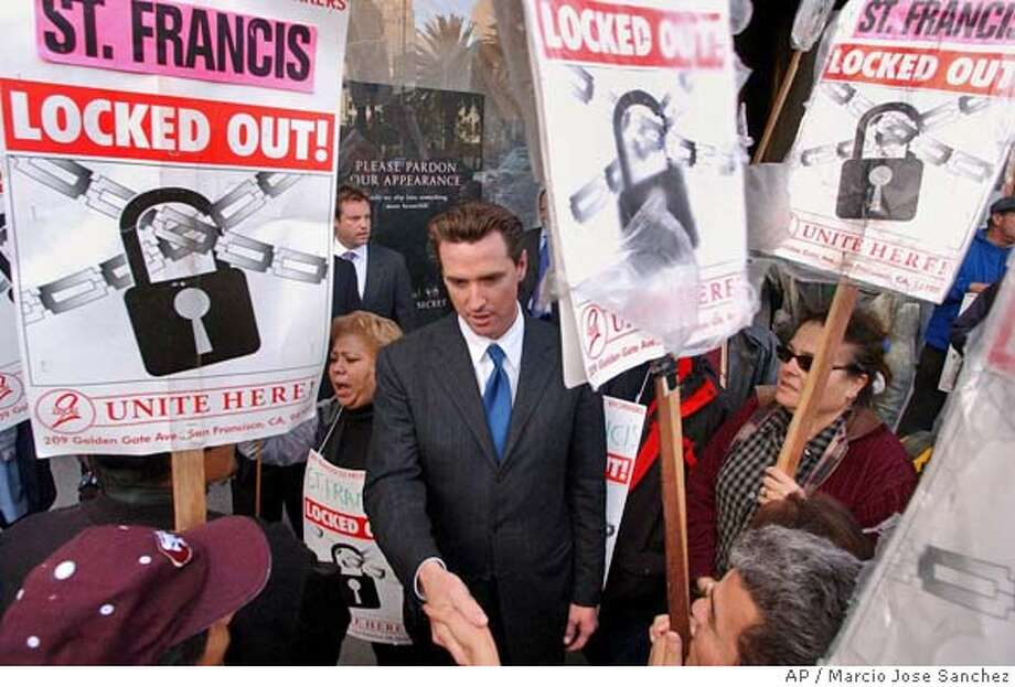 San Francisco Mayor Gavin Neswom, middle, shakes hands with striking hotel workers outside of the Westin St. Francis Hotel in San Francisco, Tuesday, Oct. 26, 2004. Facing a deadline and an ultimatum from San Francisco's mayor, the operators of 14 hotels at the center of a protracted labor dispute refused Tuesday to end their four-week lockout of unionized employees while contract negotiations proceed. (AP Photo/Marcio Jose Sanchez) Business#Business#Chronicle#11/7/2004#ALL#2star#D4#0422434096 Photo: MARCIO JOSE SANCHEZ