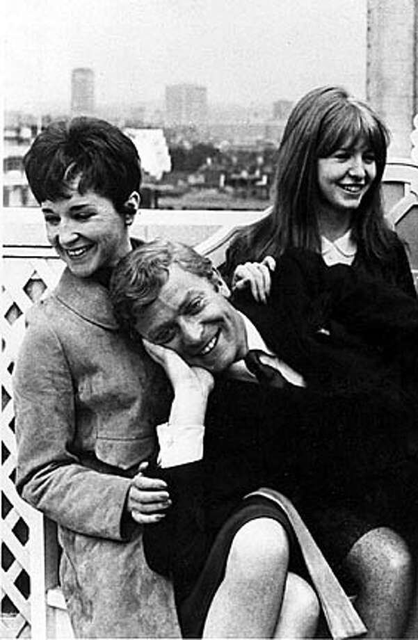 "Michael Caine in a scene from the original 1966 ""Alfie"" (the two women are unidentified)  HANDOUT"