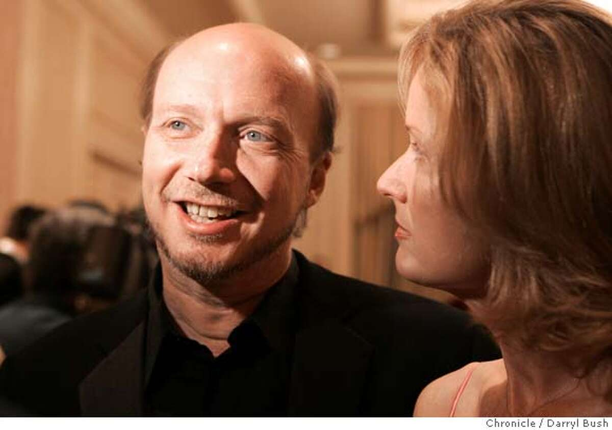 Director Paul Haggis with unidentified, right, at the 48th San Francisco International Film Festival at the Ritz-Carlton hotel. Event on 4/28/05 in San Francisco. Darryl Bush / The Chronicle