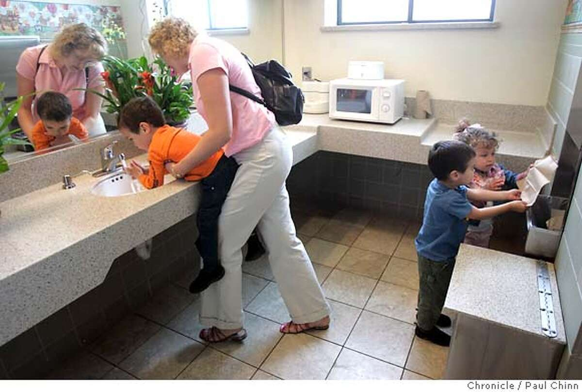 lifestyle28_097_pc.jpg Lisa Hays and her triplets Jacob, Griffin and Sierra wash up in the new family restroom at Valley Fair shopping mall on 4/26/05 in San Jose, CA. The bathroom features a microwave to heat baby bottles. In an effort to change the shopping experience, developers are setting up �lifestyle� centers, like Santana Row, which try to mimic your average Main Street, with tree-lined sidewalks and chain stores that look like boutiques. Meanwhile, malls like Valley Fair across the street are trying to stay relevant, undergoing makeovers to seem more modern and inviting. PAUL CHINN/The Chronicle MANDATORY CREDIT FOR PHOTOG AND S.F. CHRONICLE/ - MAGS OUT