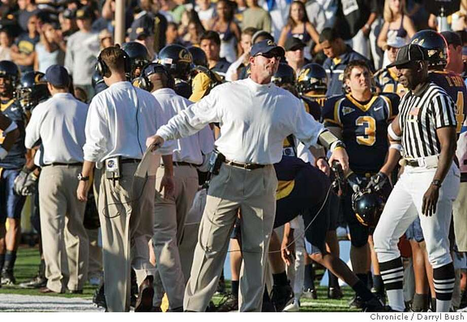 Cal coach Jeff Tedford rolls with the emotions of a day his team would eke out a one-point victory. Chronicle photo by Darryl Bush
