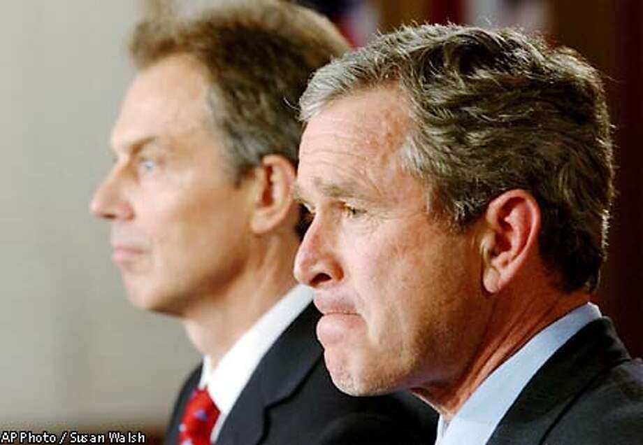 President Bush and British Prime Minister Tony Blair address the media at the White House Friday, Jan. 31, 2003, in Washington. They met to discuss the situation regarding Iraq. (AP Photo/Susan Walsh) Photo: SUSAN WALSH