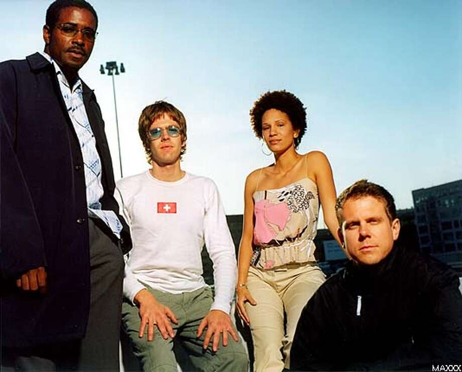 """Christopher Smith (front), president of Om Records, with members of his band, Afro-Mystik (left to right), Simone White, JSN """"The Drumfire"""" and Omega. Publicity photo courtesy of MAXXX"""