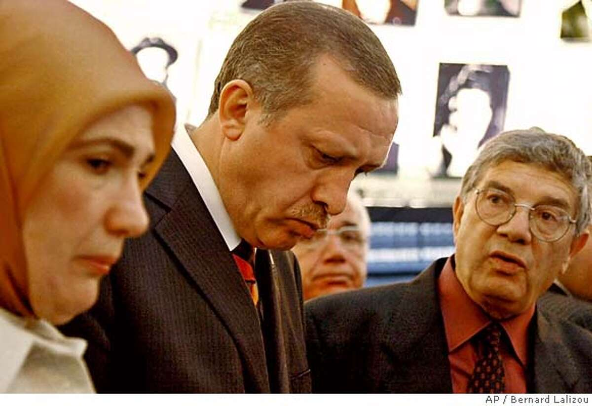 Accompanied by the director of Yad Vashem Avner Shalev, right, Turkish Prime Minister Recep Tayyip Erdogan, center, and his wife Emine visit the Yad Vashem Holocaust Museum in Jerusalem Sunday May 1, 2005. Erdogan arrived in Israel on Sunday for a visit seeking to mend relations with the Jewish state and join in a new wave of Middle East peace efforts. (AP Photo/Bernard Lalizou, Pool) POOL