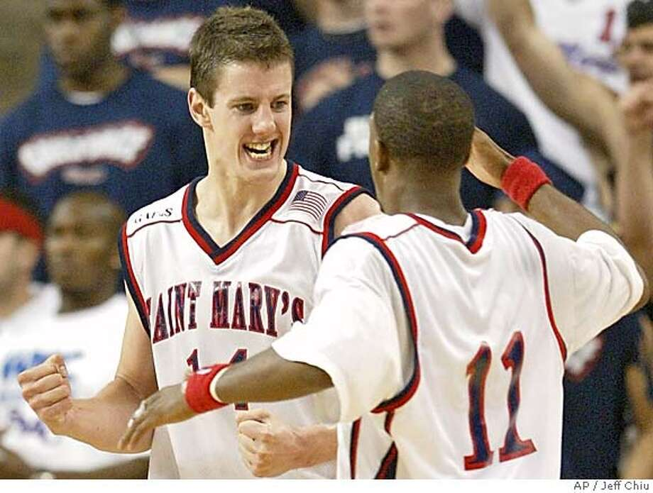 Daniel Kickert, left, and Paul Marigney of St. Mary's celebrate after a Kickert basket during the second half of the team's 79-74 win over Pepperdine in the West Coast Conference tournament in Santa Clara, Calif., on Sunday, March 7, 2004. (AP Photo/Jeff Chiu) St. Mary's point guard E.J. Rowland led the Gaels with 21 points against Pepperdine. Ran on: 11-08-2004  Daniel Kickert (left) might have to take up the slack for St. Mary's because guard Paul Marigney is out for four weeks. Ran on: 11-08-2004  Daniel Kickert (left) might have to take up the slack for St. Mary's because guard Paul Marigney is out for four weeks. Ran on: 11-08-2004  Daniel Kickert (left) might have to take up the slack for St. Mary's because guard Paul Marigney is out for four weeks. Photo: JEFF CHIU