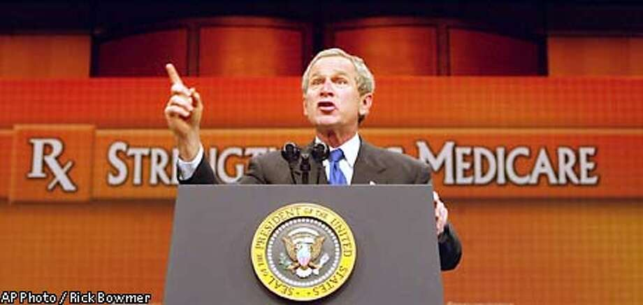 President Bush speaking a day after his State of the Union address took his medicare reform message to Grand Rapids, Mich. Wednesday, Jan. 29, 2003. Calling Medicare a ``binding commitment of a caring society,'' Bush asked Congress to spend $400 billion over the next 10 years to offer the elderly a prescription drug benefit under Medicare that would send many into private insurance plans (AP Photo/Rick Bowmer) Photo: RICK BOWMER