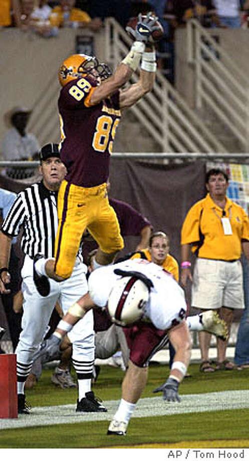 Arizona State wide receiver Matt Miller (89) jumps above Stanford defender David Bergeron for the game winning touchdown thrown by ASU quarterback Andrew Walter late in the fourth quarter Saturday, Nov. 6, 2004 in Tempe, Ariz. ASU won 34-31. (AP Photo/Tom Hood) Photo: TOM HOOD