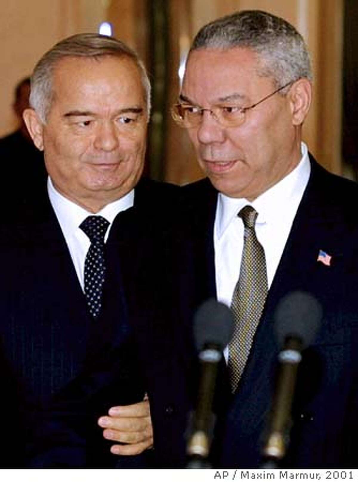 Secretary of State Colin Powell, right, and Uzbek President Islam Karimov speak at a press conference after their meeting in the Uzbek capital Tashkent Saturday, Dec. 8, 2001. (AP Photo/Maxim Marmur, Pool) Ran on: 05-01-2005 Former Secretary of State Colin Powell (right) met with Uzbek President Islam Karimov in Tashkent on Dec. 8, 2001.