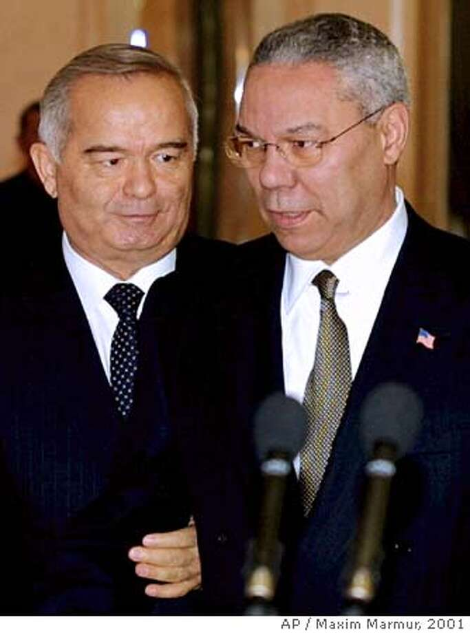Secretary of State Colin Powell, right, and Uzbek President Islam Karimov speak at a press conference after their meeting in the Uzbek capital Tashkent Saturday, Dec. 8, 2001. (AP Photo/Maxim Marmur, Pool) Ran on: 05-01-2005  Former Secretary of State Colin Powell (right) met with Uzbek President Islam Karimov in Tashkent on Dec. 8, 2001. Photo: MAXIM MARMUR