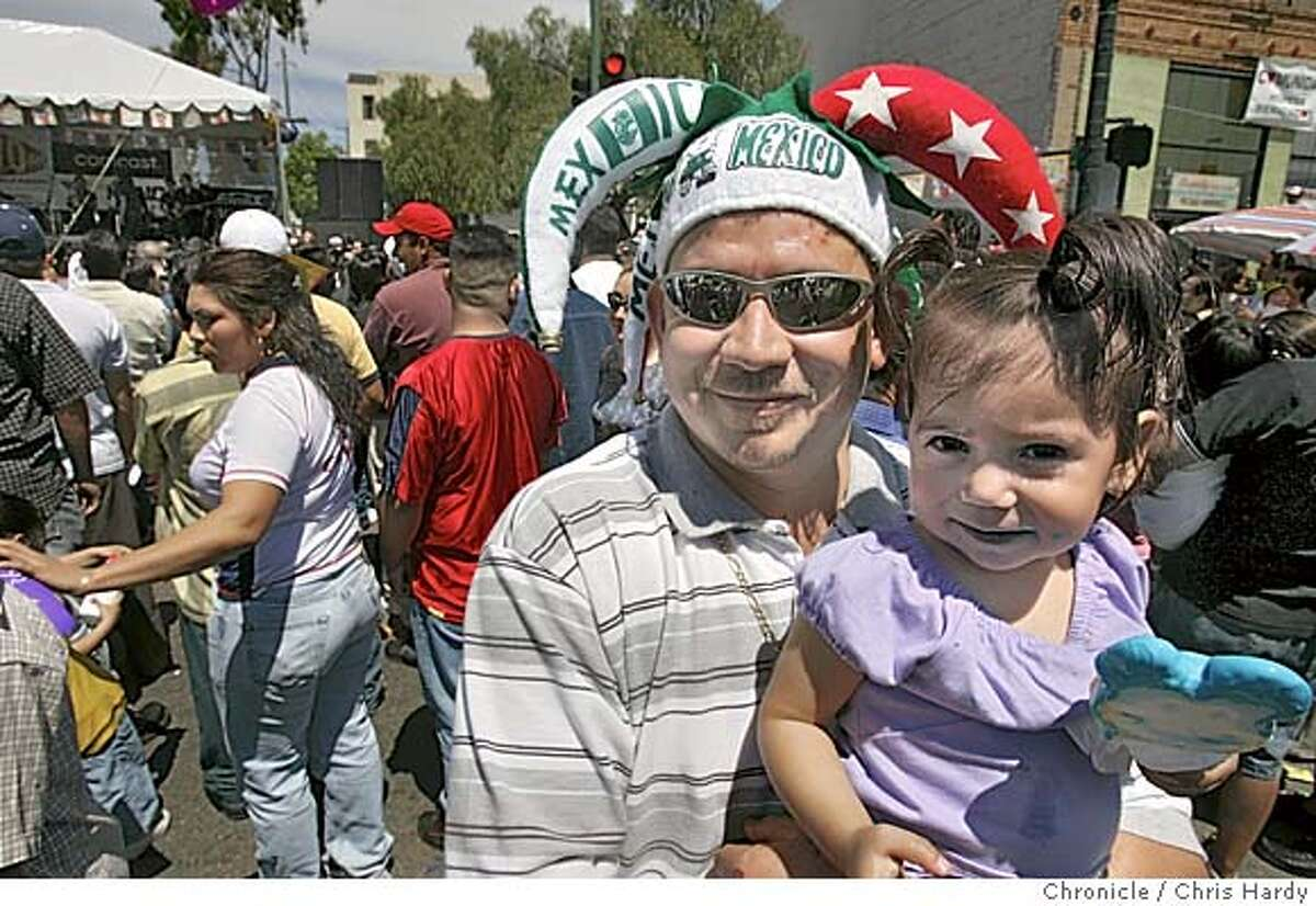 cinco_ch_093.jpg Jesus Cardenas and 2 Year old Arlet Cardenas at Cinco de Mayo festival in Oakland, the largest of several East Bay celebrations honoring the Mexican holiday. in Oakland 5/1/05 Chris Hardy / San Francisco Chronicle