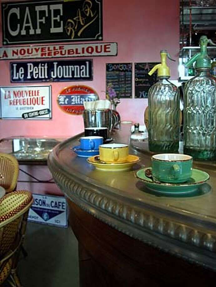 Buy French: Bistroware is poised atop a 1930s antique bar at Cafe Society. Photo by Peter Duyan