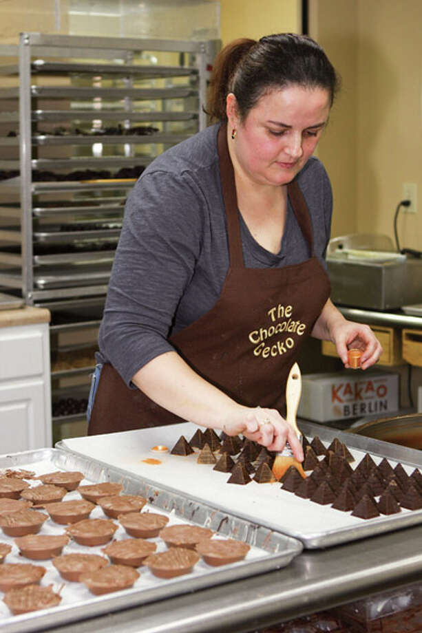 Terry Stratton, owner of The Chocolate Gecko, sells gourmet treats with unique names and flavors as a result of Stratton's extensive travels. Read the full story here Photo: Krishna Hill