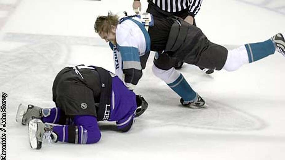SHARKS-C-28JAN03-SP-JRS-The Sharks vs. the Kings at the Compaq Arena. Kyle McLaren of the Sharks (feet in the air) fights with Brad Norton of the Kings in the first period. Chronicle photo by John Storey. Photo: John Storey