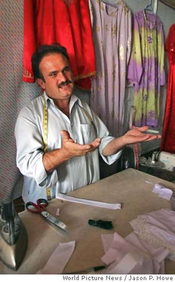 Mahmoud Mohamed, who once battled the Soviets as an Afghan mujahedeen, now works as a tailor of women's clothes in Kabul. World Picture News photo by Jason P. Howe