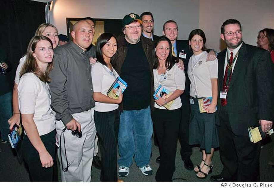 Filmmaker , center wearing cap, poses with the student council members who brought him to the Utah Valley State College campus to speak Wednesday, Oct. 20, 2004, in Orem, Utah. (AP Photo/Douglas C. Pizac) Photo: DOUGLAS C. PIZAC