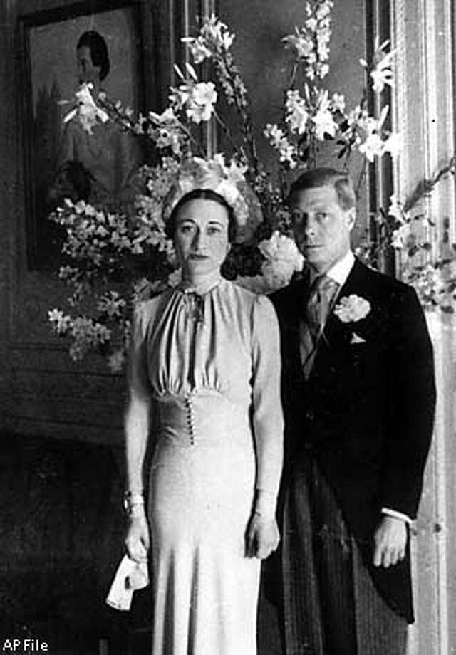 ** FILE ** The Duke and Duchess of Windsor pose after their wedding at the Chateau de Cande near Tours, France, on June 3, 1937. King Edward VIII hoped to tell Britons of his love for American divorcee Wallis Simpson and persuade them he should marry her and still keep his throne, records unsealed Thursday, Jan. 29, 2003 showed. After his abdication, Edward and his new wife became the Duke and Duchess of Windsor.(AP Photo)