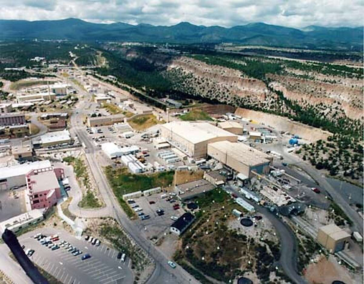 LANL 2// AN AERIAL VIEW OF LOS ALAMOS NATIONAL LABORATORY SITES. LOS ALAMOS MESON PHYSICS FACILITY. THE LAB FACILITIES AND TOWN ARE SITUATED ON MESAS WITH DEEP CANYONS BETWEEN THEM.