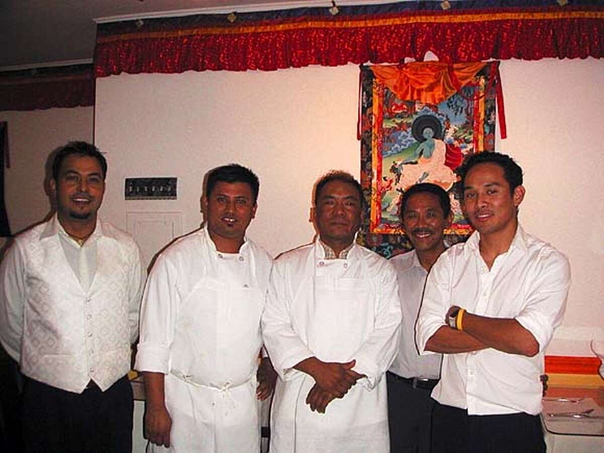 Taste of the Himalayas. From left to right: Deepak Shahi (server/ brother of co-owner Govind Shahi), Sundar Dahal (chef), Pasang Sherpa (chef), Pemba Sherpa Sr., Pemba Sherpa Jr. (co-owner)