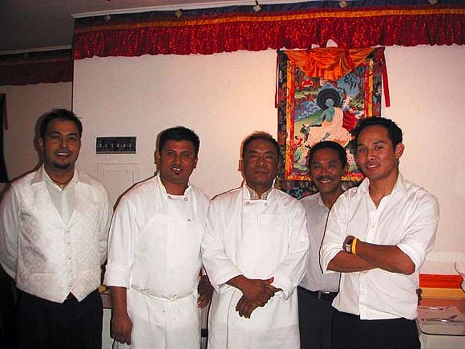 Taste of the Himalayas. From left to right:  Deepak Shahi (server/ brother of co-owner Govind  Shahi), Sundar Dahal (chef), Pasang Sherpa (chef),  Pemba Sherpa Sr., Pemba Sherpa Jr. (co-owner) Photo: Courtesy Cynthia Liu