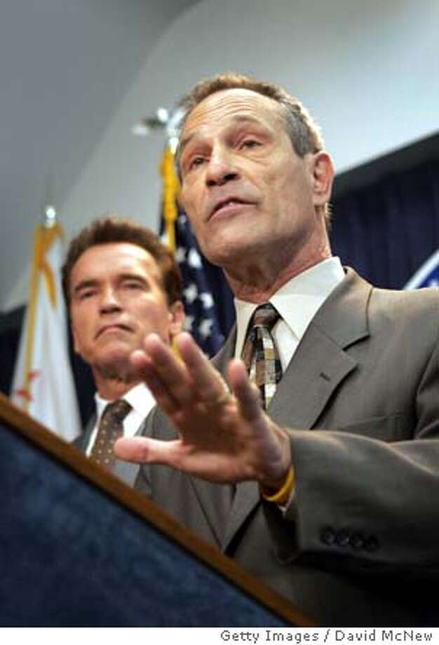 LOS ANGELES, CA - APRIL 29: Superintendent of the San Diego Unified School District, Alan Bersin, speaks as California Gov. Arnold Schwarzenegger looks on during a press conference to announce that Schwarzenegger has selected Bersin to take over for Former Los Angeles Mayor Richard Riordan as California's State Schools Chief on April 29, 2005 in Los Angeles, California. Richard Riordan announced on April 27 that he is resigning from the position which reportedly left him frustrated that he was confined to a largely ineffectual post. (Photo by David McNew/Getty Images) *** Local Caption *** Alan Bersin;Arnold Schwarzenegger Photo: David McNew