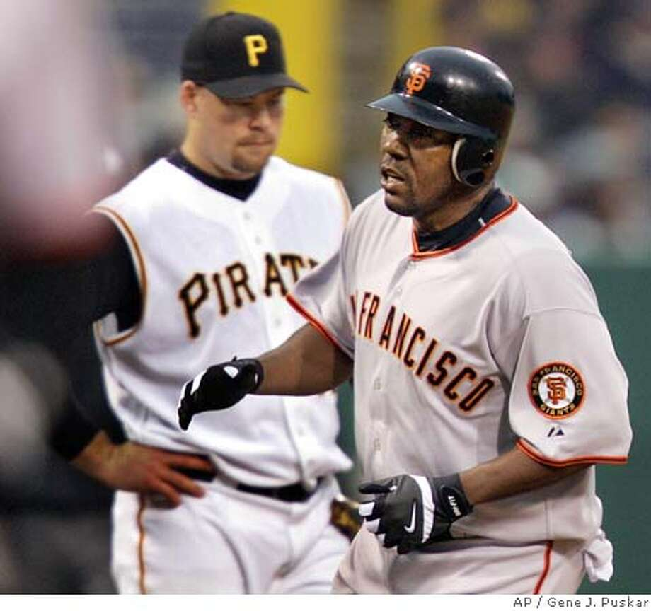 San Francisco Giants' Deivi Cruz rounds third base past Pittsburgh Pirates third baseman Ty Wigginton after hitting a first-inning two-run homer off Pirates starter Dave Williams, Saturday, April 30, 2005, in Pittsburgh. (AP Photo/Gene J. Puskar) Photo: GENE J. PUSKAR