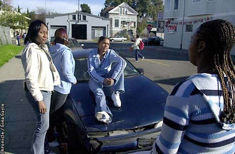Oakland plans to pass its no loiting law which means that people standing on the street can be picked up by police. These West Oakland neighborhood girls say they have been questioned by the police in front of their own homes before when they were just trying to get outside for some air and think it may get worse if a law is passed. From Left are: Monique Dixon,17, Michelle Conners,20, (with back turned) Nicole Martin,14, (on car) and Tyeesha Martin, 17. Photo by Gina Gayle/The SF Chronicle. Photo: GINA GAYLE