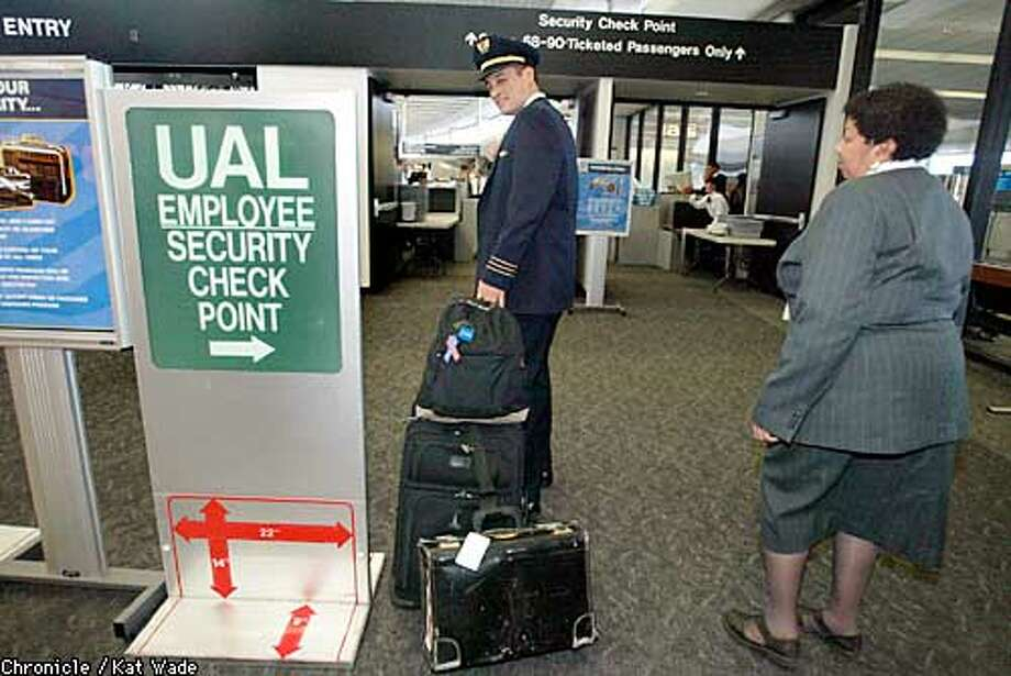 United Airline's pilot, Phil Barmore heads for the employee security check before piloting a flight Wednesday from San Francisco International Airport SFO. Pilots may soon be permitted to carry guns in the cockpit. SAN FRANCISCO CHRONICLE PHOTO BY KAT WADE Photo: KAT WADE
