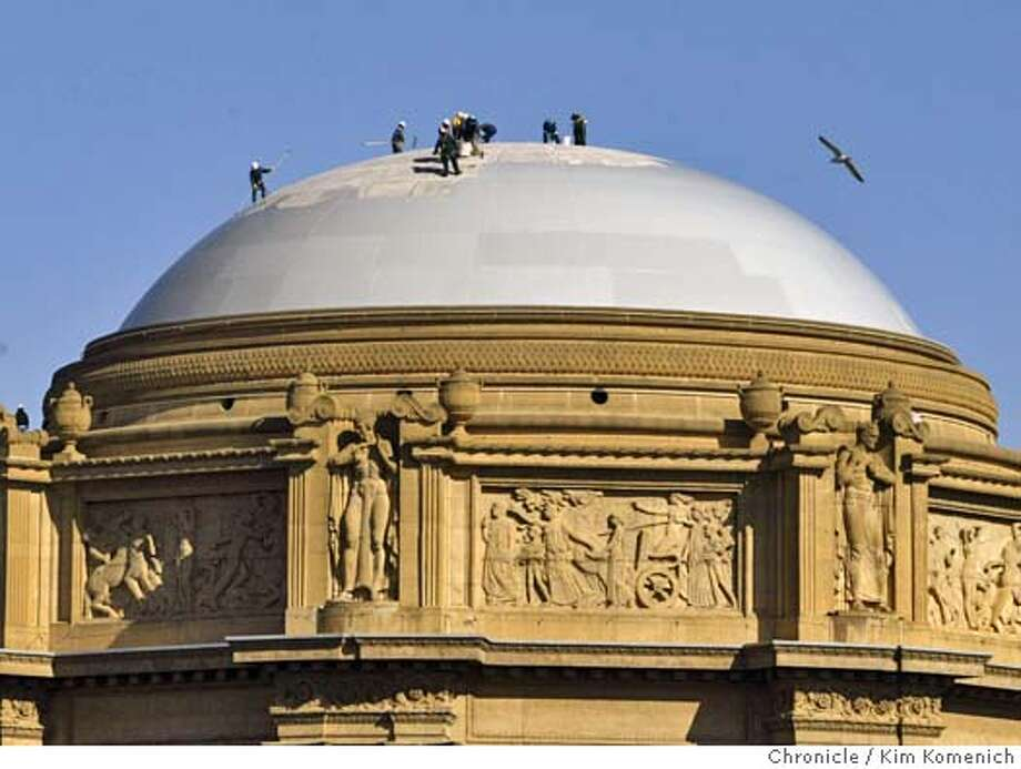 Safely tethered to the building, painters apply a new coat of paint to the dome of the Palace of Fine Arts.  Photo by Kim Komenich in San Francisco. Photo: Kim Komenich