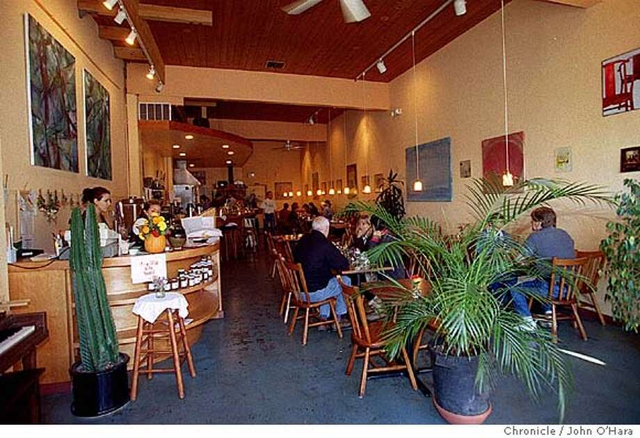 """NBLUCY-C-29OCT99-NF-JO  Sebastopol, Ca. """"Lucy's Cafe"""" 110 North Main St.  Interior view from front door.  Photo by.........John O'Hara Ran on: 11-05-2004  Exposed brick walls and cement floors make for a casual atmosphere at Lucy's. Photo: JOHN O'HARA"""