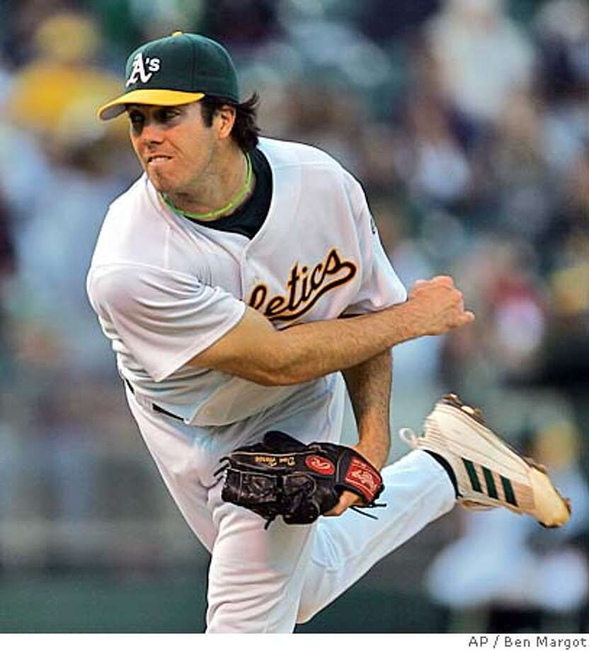 Oakland Athletics pitcher Dan Haren works against the Seattle Mariners in the first inning Friday, April 29, 2005, in Oakland, Calif. (AP Photo/Ben Margot) Photo: BEN MARGOT