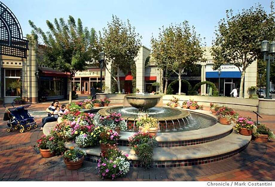 Large new faountain where one can have rest of have lunch. Here, a family relaxes.  From Berkeley to San Francisco, shoppers are spurning the shops in San Francisco and flocking to Walnut Creek's Broadway Plaza, one of the most beautiful shopping centers in Northern California.  Event on 10/13/04 in Walnut Creek .Photo: Mark Costantini/S.F. Chronicle Photo: Mark Costantini