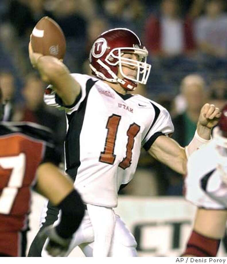 Utah quarterback Alex Smith gets a pass off under pressure during the first half of his game against San Diego State Saturday Oct. 30, 2004 in San Diego. Smith threw five touchdown passes by the beginning of the fourth quarter. (AP Photo/Denis Poroy) Sports#Sports#Chronicle#11/5/2004#ALL#5star##0422441930 Photo: DENIS POROY