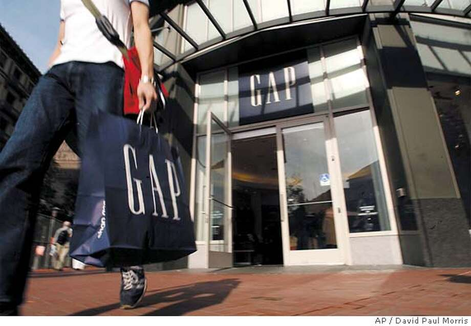 ** FILE ** A shopper leaves a Gap store in San Francisco, Tuesday, Nov. 12, 2002. In a press release Thursday, Feb. 26, 2004, the Gap said net income for the fourth quarter rose to $355.8 million (AP Photo/David Paul Morris) A shopper leaves a Gap in San Francisco. The chain is making strides in inventory control and cutting back on markdowns. Business#Business#Chronicle#11/5/2004#ALL#5star##0421641975 Photo: DAVID PAUL MORRIS