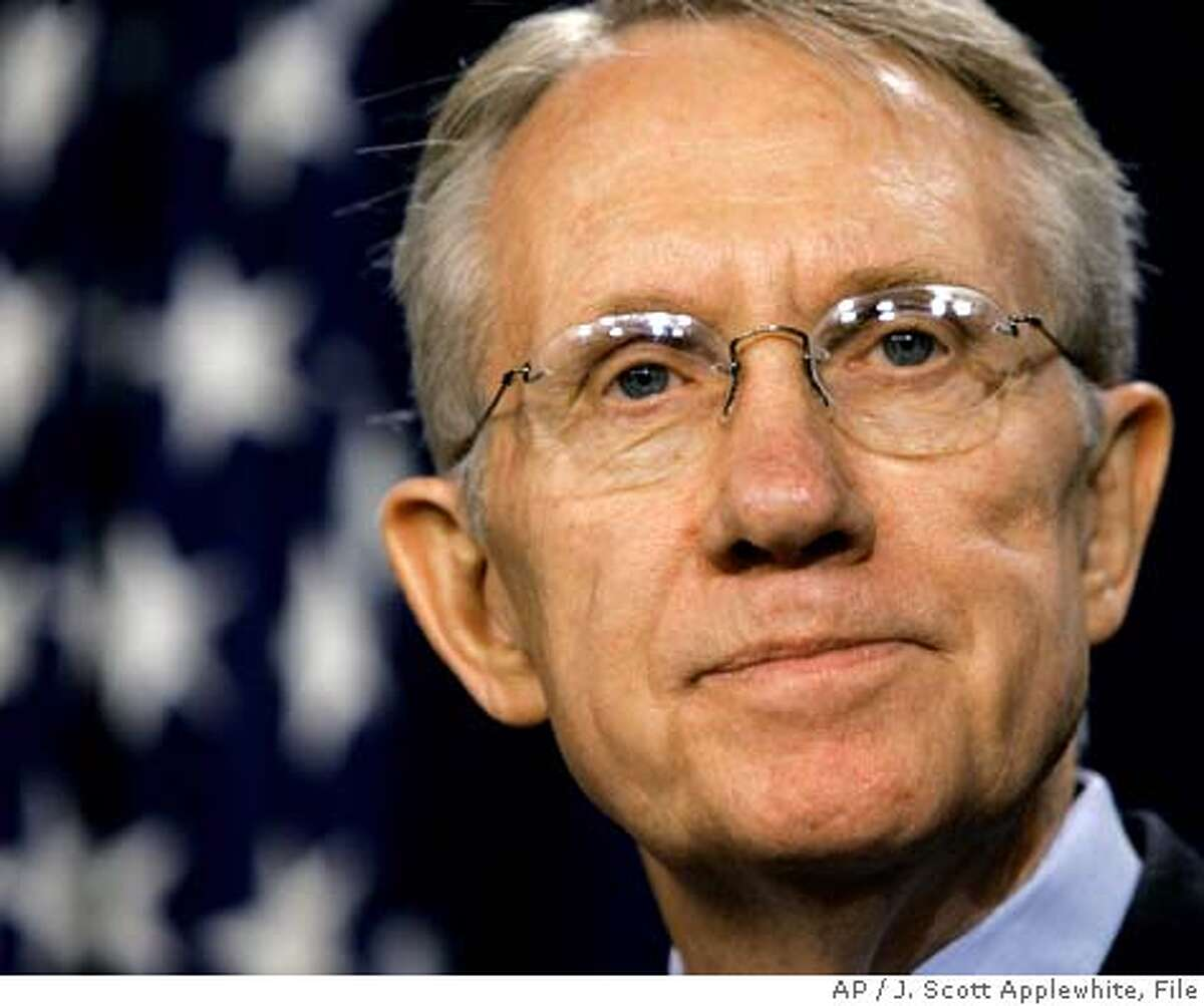 ** FILE ** Sen. Harry Reid, D-Nev., speaks to reporters in the Capitol after winning election by his Democratic peers as the new Senate minority leader, in Washington, Tuesday, Nov. 16, 2004. Reid is quietly talking to the Senate's chief Republican about confirming at least two of President Bush's blocked judicial nominees but only as part of a compromise that would require the GOP to end its threat to eliminate judicial filibusters, officials say. (AP Photo/J. Scott Applewhite)