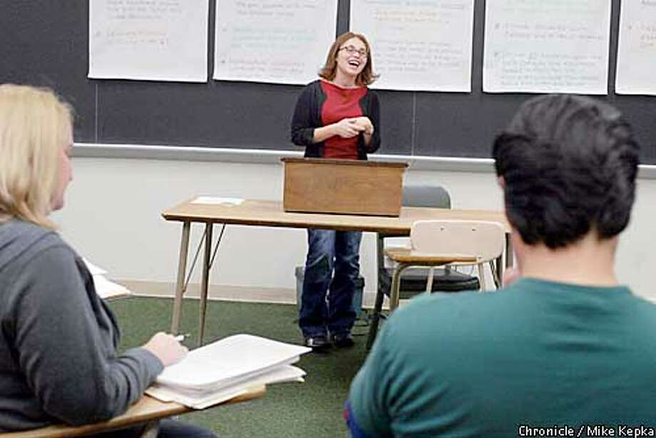 Guadalupe Guzman enjoys a humorous moment during a presentation to her education class at Canada College. Chronicle photo by Mike Kepka