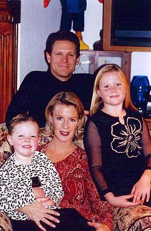 Brian Jacobson, wife Therese, daughters Haley (9) and Taylor (5).�Brian was severely injured in a skiing accident last winter and has been diagnosed as a quadriplegic.