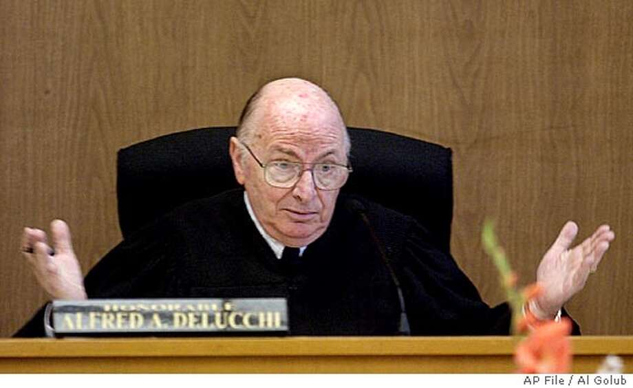 ** FILE ** Judge Alfred A. Delucchi gestures in a Redwood City, Calif., courtroom in the Scott Peterson trial in this July 29, 2004 file photo. Jurors began deliberating the fate of Scott Peterson on Wednesday, Nov. 3, more than five months after testimony began in the murder of his wife and their unborn son. Jurors must decide whether Peterson killed his pregnant wife and dumped her body in San Francisco Bay, or was merely a straying husband who was framed. (AP Photo/Al Golub, pool, File) POOL PHOTO JULY 29 2004 FILE PHOTO Ran on: 11-05-2004  Dan Abrams, MSNBC cable TV anchor, reports from outside the San Mateo County courthouse. Photo: AL GOLUB