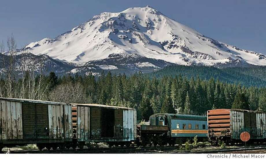 Mt. Shasta as seen from the small town of McCloud, Ca. Abandoned train cars against the snow-capped mountain. Mt. Shasta, Ca. 4/14/05 Mt. Shasta, Ca Michael Macor / San Francisco Chronicle Photo: Michael Macor