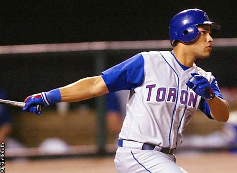 Toronto Blue Jays' Jose Cruz Jr. follows the flight of his RBI double in the first inning against the Baltimore Orioles, Thursday, Sept. 19, 2002, at Camden Yards in Baltimore. (AP Photo/Roberto Borea) Photo: ROBERTO BOREA