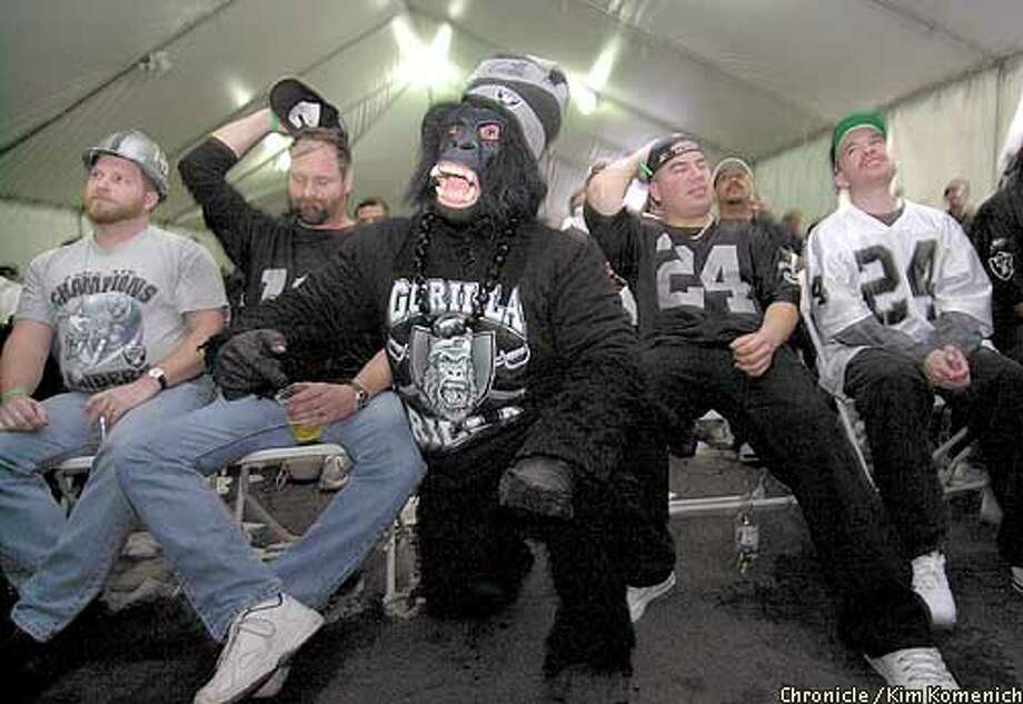 The gorilla registers shock, and fans show defeat at Ricky's Sports Lounge and Steakhouse in San Leandro, where they watched the Raiders fall. Chronicle photo by Kim Komenich