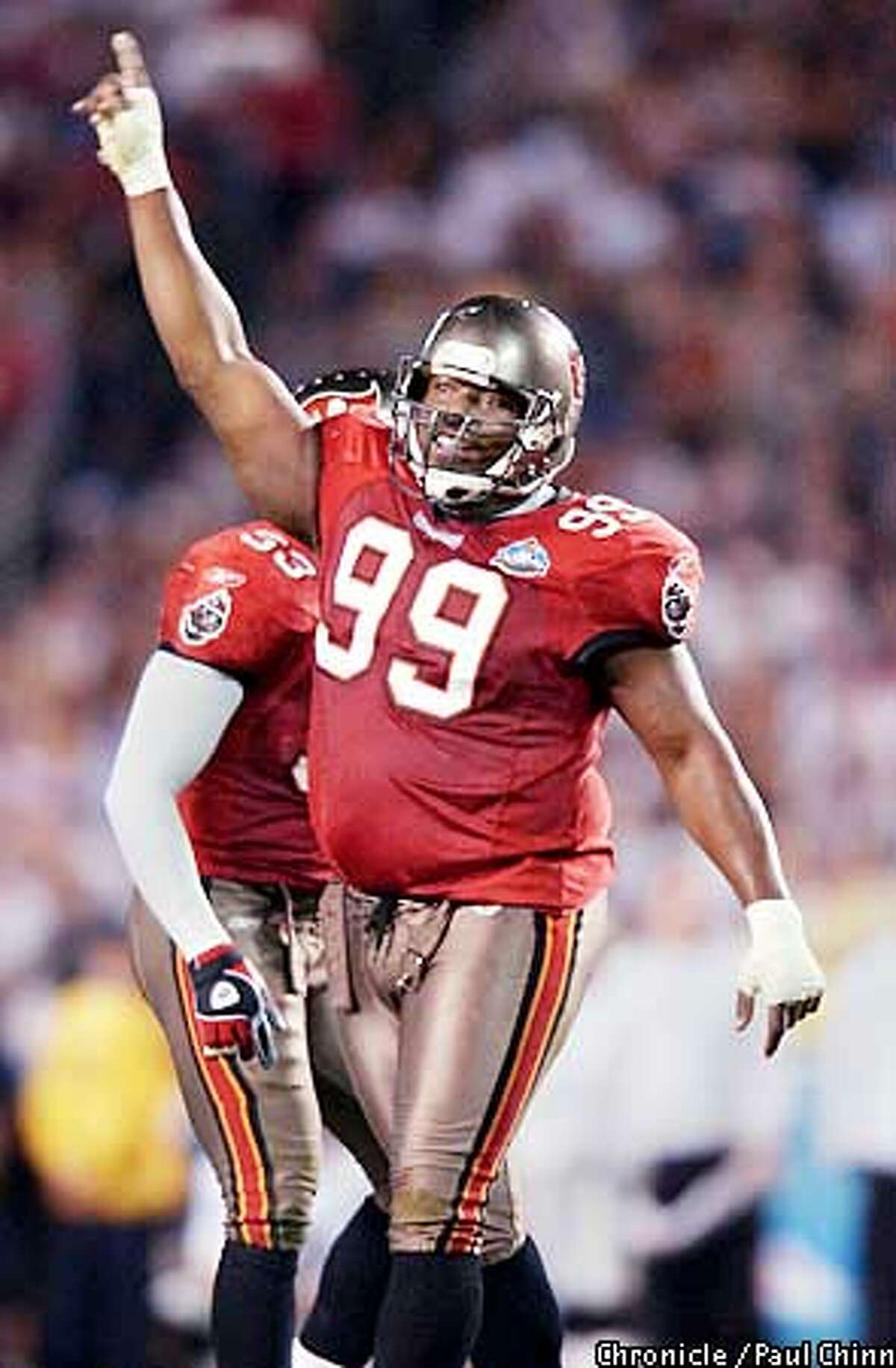 Warren Sapp is one of the few players on the Bucs' defense who ranks with the Pittsburgh greats. Chronicle photo by Paul Chinn