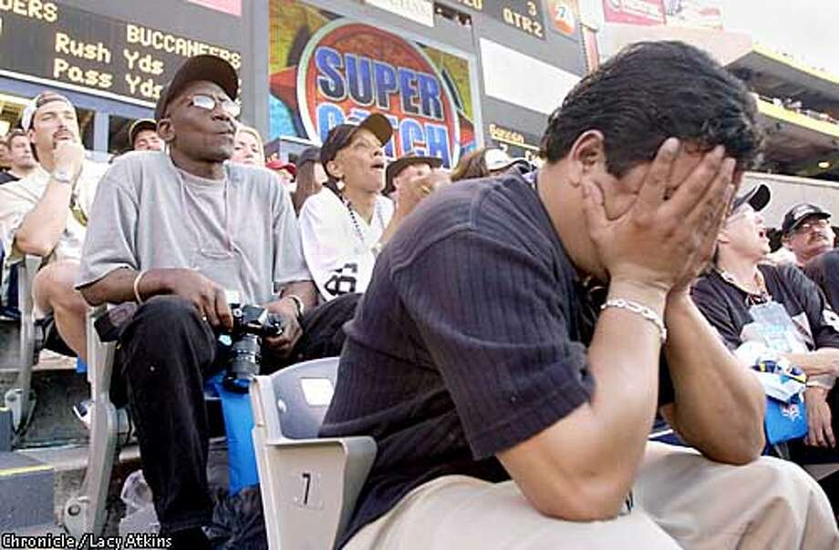 Raiders fan John Farias of Sacramento buries his face in his hands after Tampa Bay scores a second-quarter touchdown. Chronicle photo by Lacy Atkins
