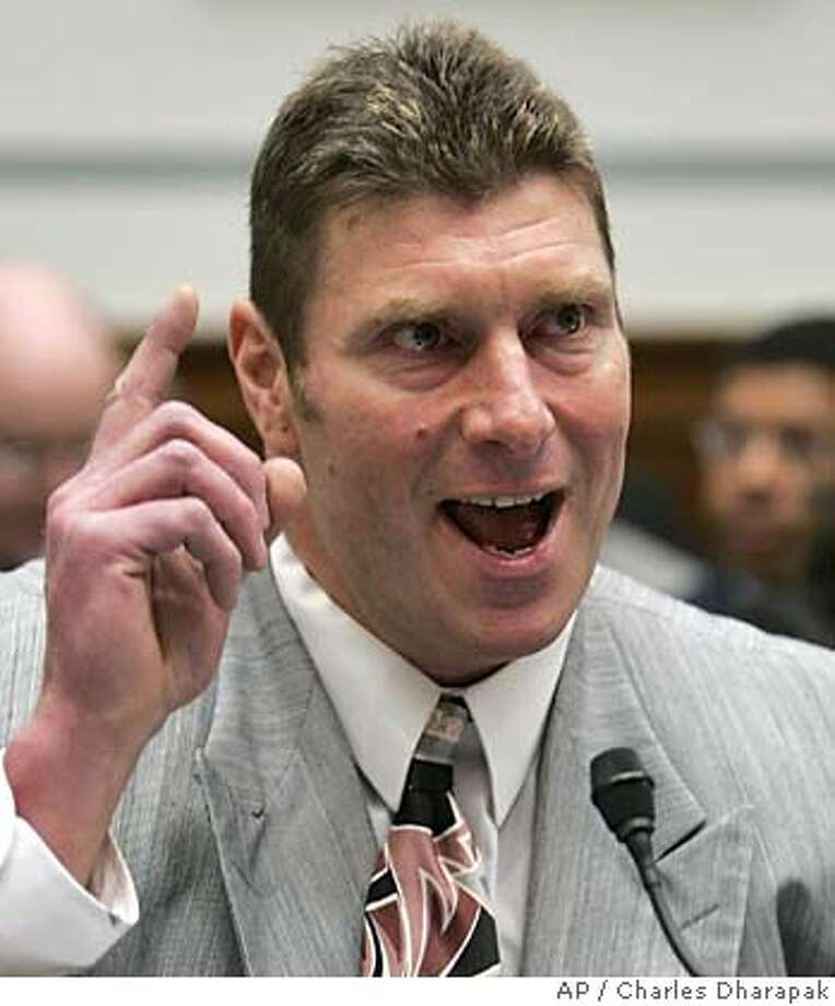 """Steve Courson, former offensive lineman for the Pittsburgh Steelers and Tampa Bay Buccaneers, testifies regarding the NFL's steroid policy during a hearing at the House Committee on Government Reform on Capitol Hill, Wednesday, April 27, 2005. The NFL's steroids policy is tough, """"but it's not perfect,"""" the head of a congressional committee said Wednesday, adding that he plans to introduce a bill governing drug testing across the spectrum of U.S. sports. (AP Photo/Charles Dharapak) Photo: CHARLES DHARAPAK"""