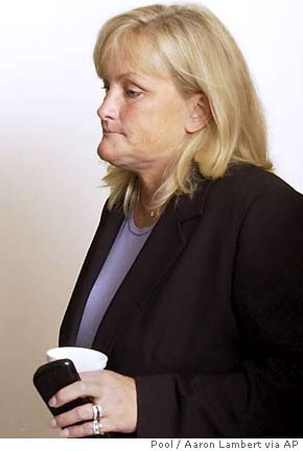 Debbie Rowe, 's ex-wife and mother of two of his children, walks out of the courtroom at the Santa Barbara County Courthouse Thursday, April 28, 2005, in Santa Maria, California, during a break in his child molestation trial. (AP Photo/Aaron Lambert,pool) Photo: AARON LAMBERT