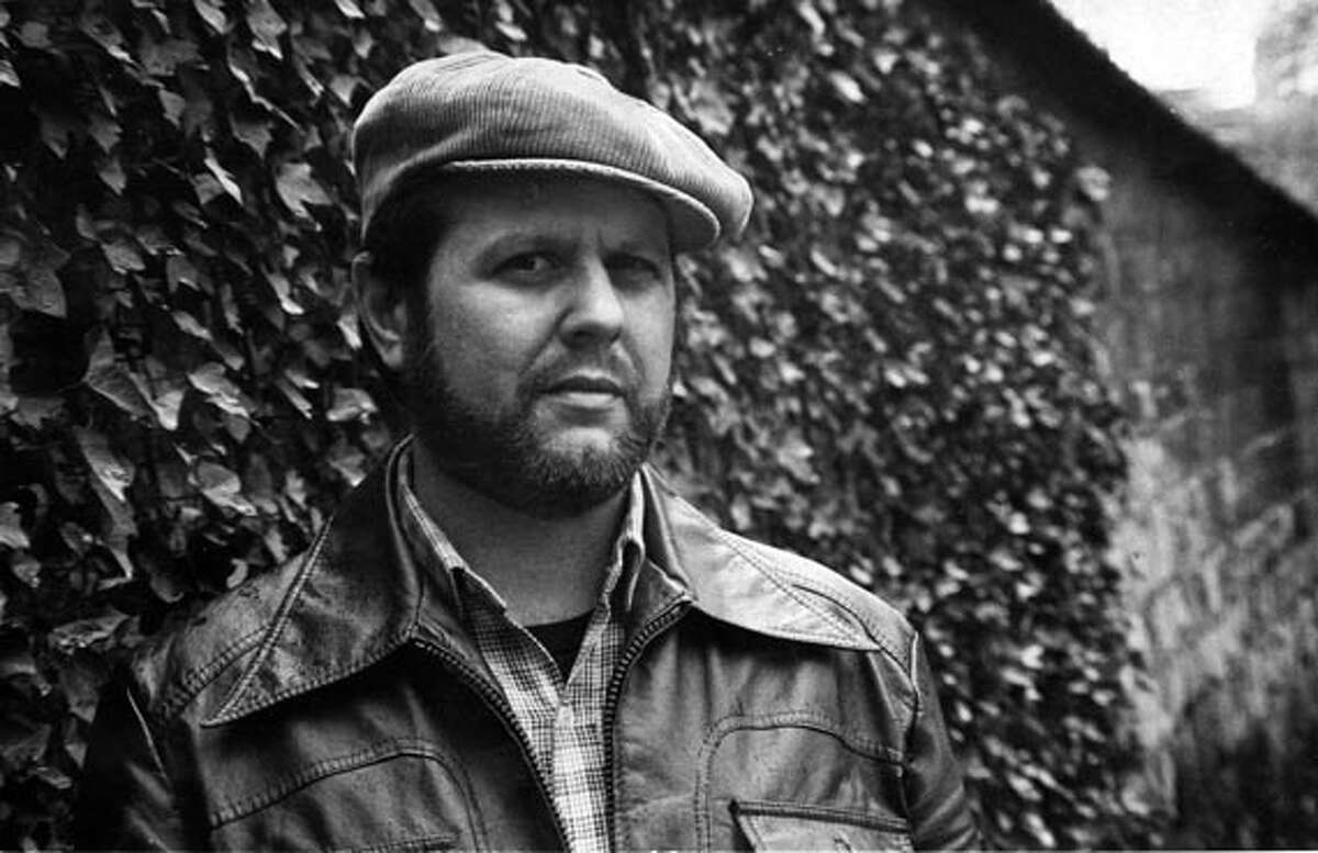 """Photo of """"Bob Avakian in front of the Wall of Communards in Paris, 1981."""""""